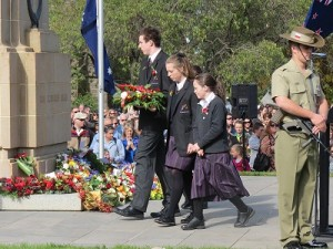 Student leaders lay a reef at community Anzac Day Ceremony